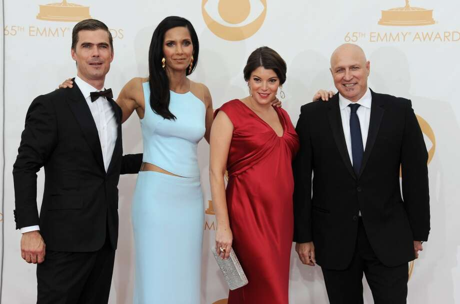 Hugh Acheson, from left, Padma Lakshmi, Gail Simmons, and Tom Colicchio arrive at the 65th Primetime Emmy Awards at Nokia Theatre on Sunday Sept. 22, 2013, in Los Angeles.  (Photo by Jordan Strauss/Invision/AP) Photo: Jordan Strauss, Associated Press