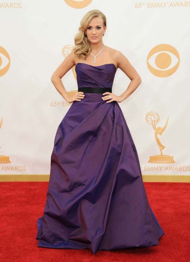 Carrie Underwood arrives at the 65th Primetime Emmy Awards at Nokia Theatre on Sunday Sept. 22, 2013, in Los Angeles.  (Photo by Jordan Strauss/Invision/AP) Photo: Associated Press