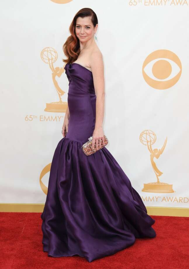 Alyson Hannigan arrives at the 65th Primetime Emmy Awards at Nokia Theatre on Sunday Sept. 22, 2013, in Los Angeles.  (Photo by Jordan Strauss/Invision/AP) Photo: Associated Press