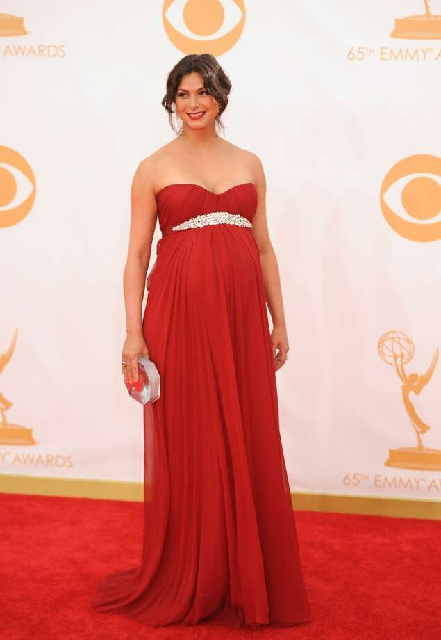 Actress Morena Baccarin arrives on the red carpet for the 65th Emmy Awards in Los Angeles on September 22, 2013. Photo: AFP/Getty Images