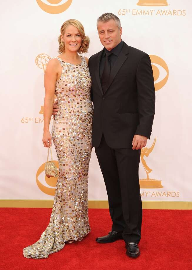 Actor Matt LeBlanc (R) and Andrea Anders arrive on the red carpet for the 65th Emmy Awards in Los Angeles on September 22, 2013. Photo: AFP/Getty Images