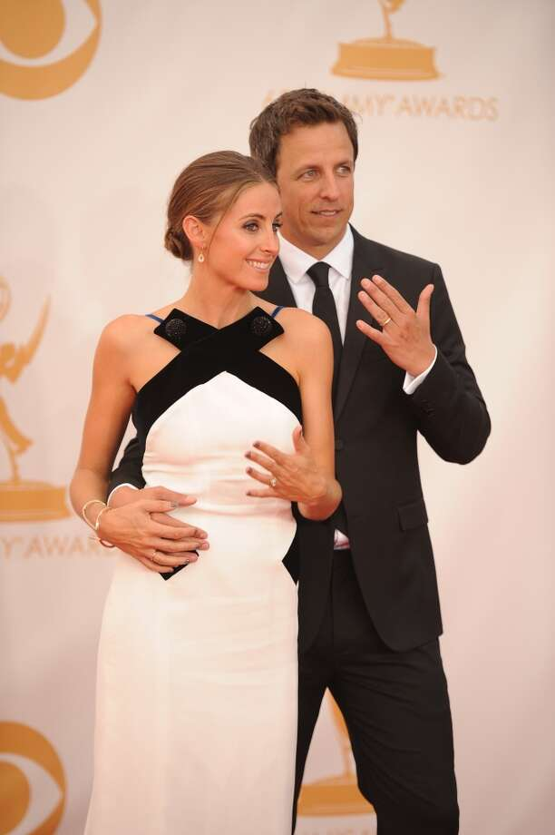 Seth Meyers and wife Alexi Ashe arrive on the red carpet for the 65th Emmy Awards in Los Angeles, California, on September 22, 2013. Photo: AFP/Getty Images