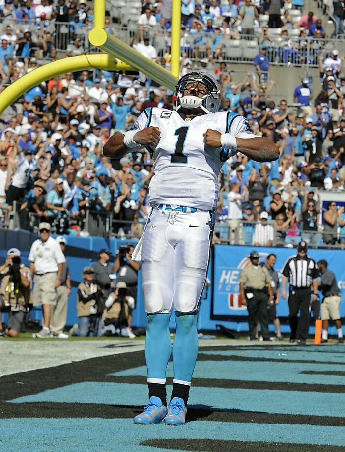 Carolina Panthers' Cam Newton (1) celebrates his touchdown run against the New York Giants during the second half of an NFL football game in Charlotte, N.C., Sunday, Sept. 22, 2013. (AP Photo/Mike McCarn) Photo: Mike McCarn, Associated Press