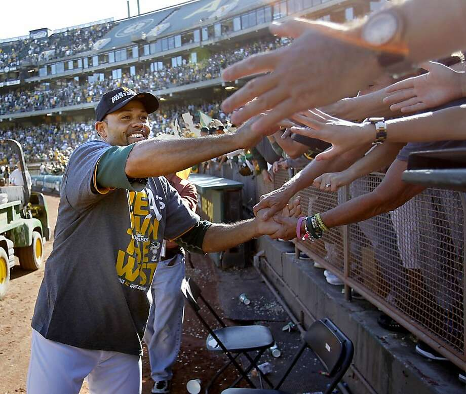 Coco Crisp slapped a lot of hands as he walked around the coliseum thanking the fans. The Oakland A's defeated the Twins 11-7 and captured the American League Western division championship Sunday September 22, 2013 at O.co coliseum in Oakland, Calif. Photo: Brant Ward, The Chronicle