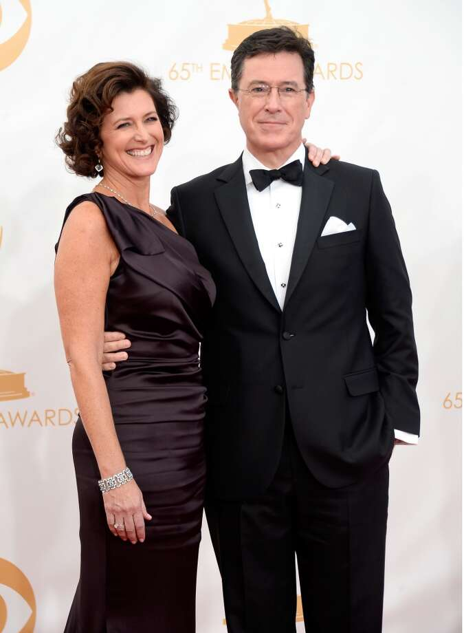 Actor Stephen Colbert and his wife Evelyn Colbert (R) arrive at the 65th Annual Primetime Emmy Awards held at Nokia Theatre L.A. Live on September 22, 2013 in Los Angeles, California.  (Photo by Frazer Harrison/Getty Images) Photo: Frazer Harrison, Getty Images