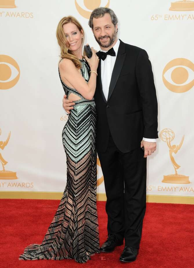 Leslie Mann, left, and Judd Apatow arrive at the 65th Primetime Emmy Awards at Nokia Theatre on Sunday Sept. 22, 2013, in Los Angeles.  (Photo by Jordan Strauss/Invision/AP) Photo: Jordan Strauss, Associated Press