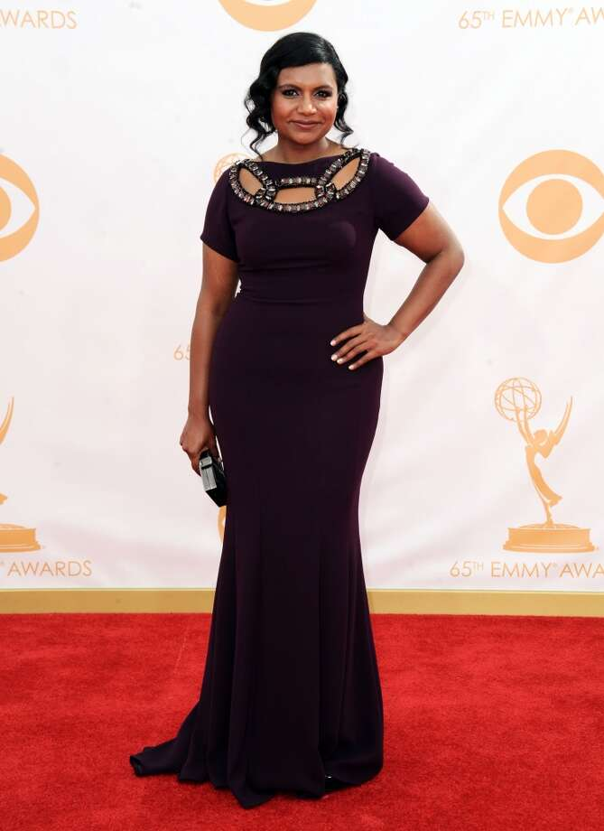 Mindy Kaling arrives at the 65th Primetime Emmy Awards at Nokia Theatre on Sunday Sept. 22, 2013, in Los Angeles.  (Photo by Jordan Strauss/Invision/AP) Photo: Jordan Strauss, Associated Press