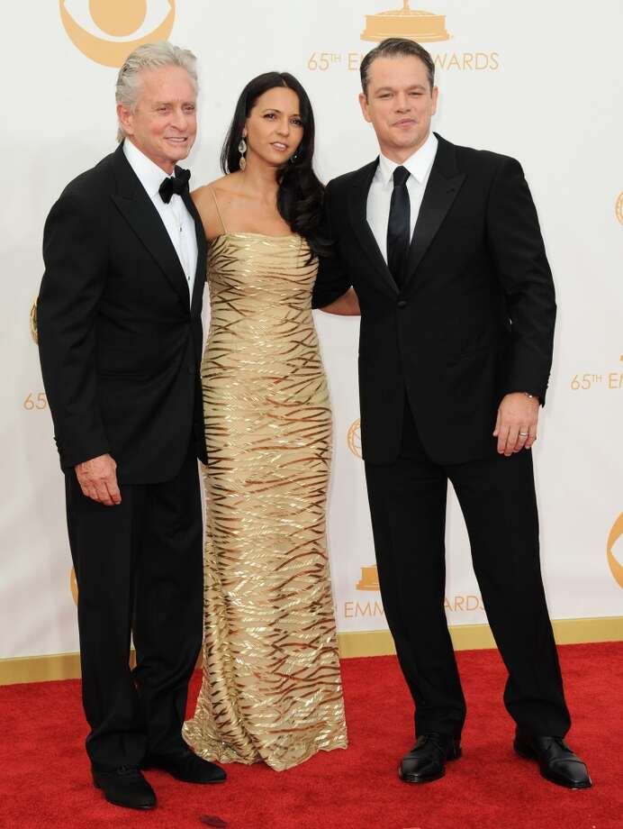 Michael Douglas, from left, Luciana Barroso, and Matt Damon arrive at the 65th Primetime Emmy Awards at Nokia Theatre on Sunday Sept. 22, 2013, in Los Angeles.  (Photo by Jordan Strauss/Invision/AP) Photo: Jordan Strauss, Associated Press