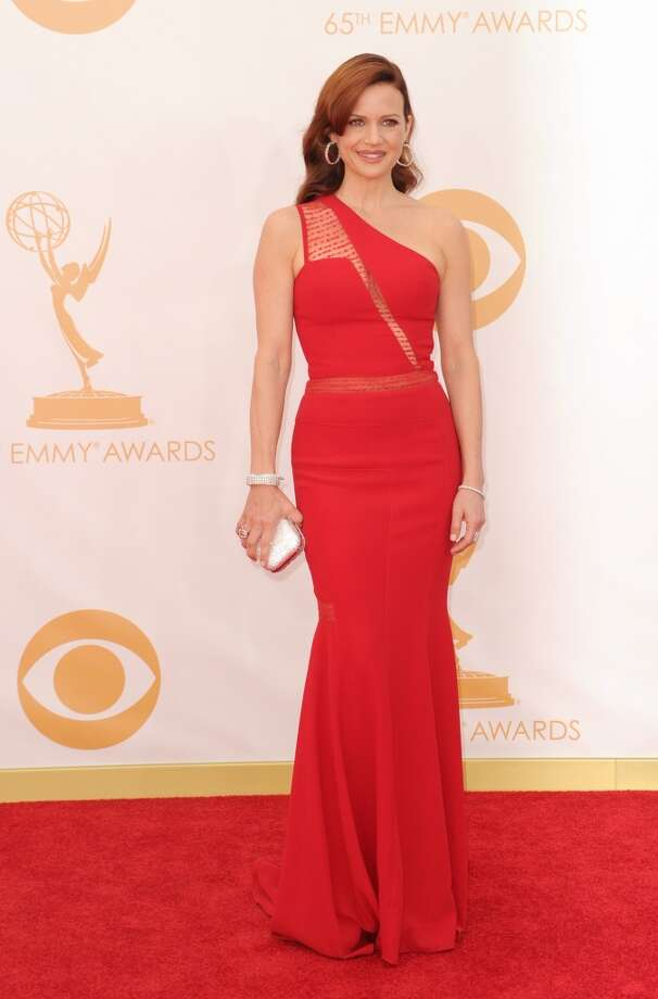 Actress Carla Gugino arrives on the red carpet for the 65th Emmy Awards in Los Angeles on September 22, 2013.  AFP PHOTO / Robyn BeckROBYN BECK/AFP/Getty Images Photo: ROBYN BECK, AFP/Getty Images
