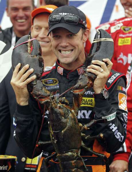 Matt Kenseth, rejoicing with a lobster, is the third driver to win the first two races of the Chase since its inception. Photo: Mary Schwalm / Associated Press