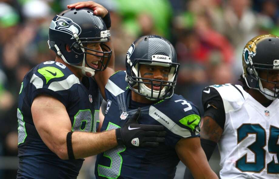Seattle Seahawks quarterback Russell Wilson celebrates with Zach Miller after Miller's second touchdown against the Jacksonville Jaguars on Sunday, Sept. 22, 2013 at CenturyLink Field in Seattle. Photo: SEATTLEPI.COM