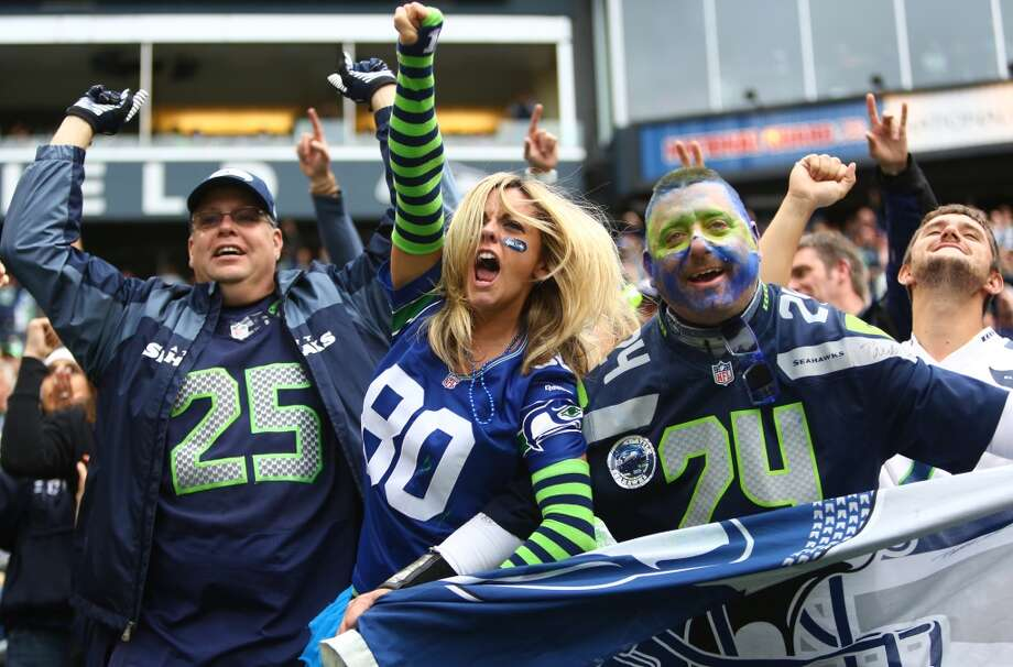 Seattle Seahawks fans cheer as the Jacksonville Jaguars turnover control of the ball on Sunday, Sept. 22, 2013 at CenturyLink Field in Seattle. Photo: SEATTLEPI.COM