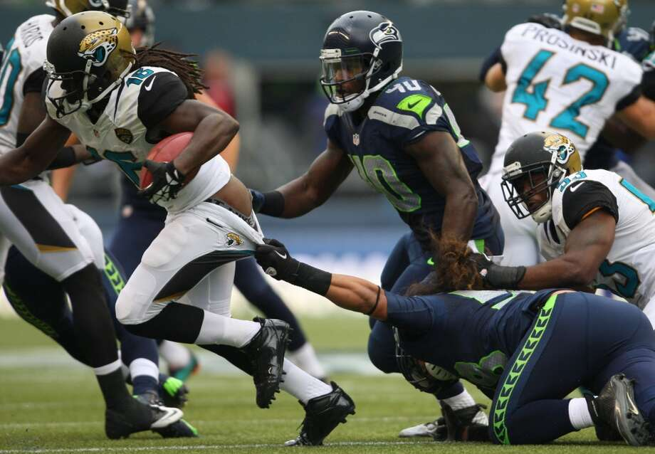 Jacksonville Jaguars player Denard Robinson escapes the grasp of Seattle Seahawks player John Lotulelei during the first quarter on Sunday, Sept. 22, 2013 at CenturyLink Field in Seattle. Photo: SEATTLEPI.COM