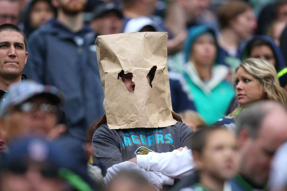 A Jacksonville Jaguars fan wears a bag on his head as his team falls to the Seattle Seahawks on Sunday, Sept. 22, 2013 at CenturyLink Field in Seattle.  Photo: SEATTLEPI.COM