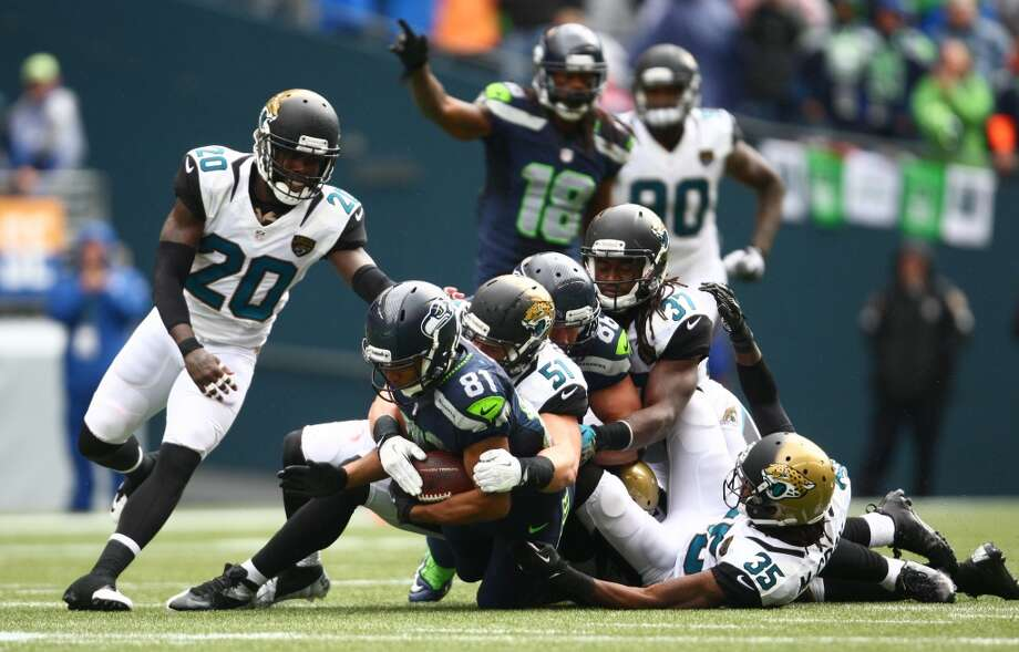 Seattle Seahawks player Golden Tate pulls along Jacksonville Jaguars defenders as he is taken down on Sunday, Sept. 22, 2013 at CenturyLink Field in Seattle. Photo: SEATTLEPI.COM