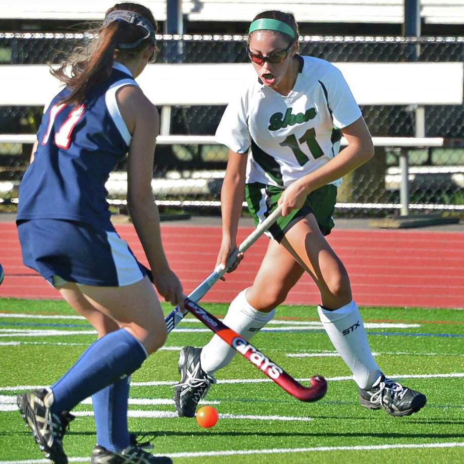 Shenendehowa's #11 Nicole daCunha, at right, gets past Saratoga's #11 Lauren Farley during their game at Shenendehowa Friday Sept. 20, 2013, in Clifton park, NY.     (John Carl D'Annibale / Times Union) Photo: John Carl D'Annibale / 00023934A