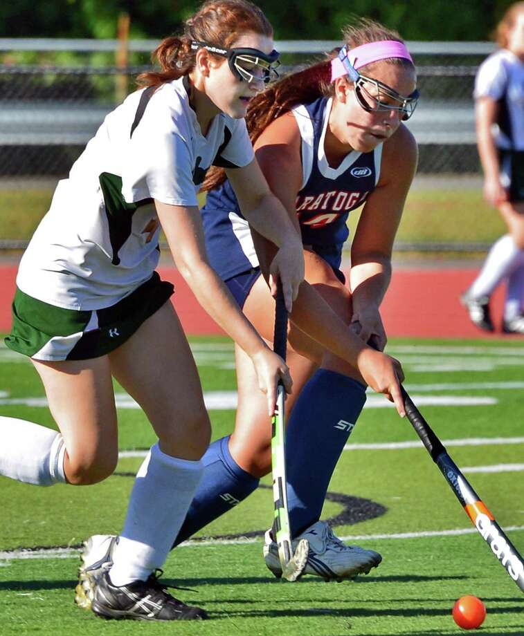 Shenendehowa's #4 Casey Stata, left, and Saratoga's #24 Ann Mahoney during their game at Shenendehowa Friday Sept. 20, 2013, in Clifton park, NY.     (John Carl D'Annibale / Times Union) Photo: John Carl D'Annibale / 00023934A