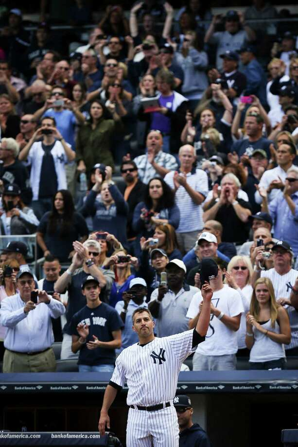 New York Yankees starting pitcher Andy Pettitte makes a curtain call after being relieved in the eight inning of a baseball game against the San Francisco Giants, Sunday, Sept. 22, 2013, in New York. (AP Photo/John Minchillo) ORG XMIT: NYJM115 Photo: John Minchillo / FR170537 AP
