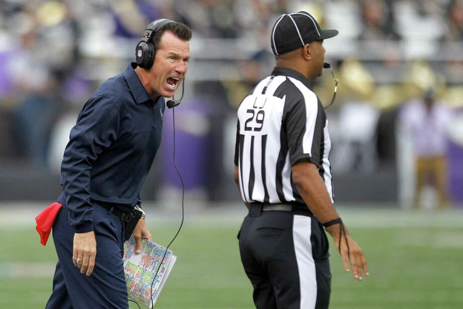 Texans coach Gary Kubiak vents to line judge Adrian Hill during the third quarter. The Texans committed 14 penalties for 113 yards. Photo: Brett Coomer, Staff / © 2013  Houston Chronicle