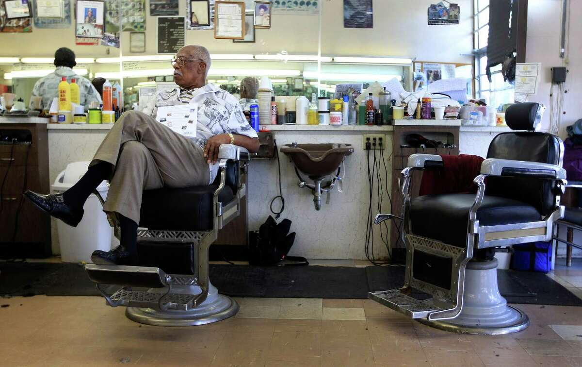 Sam Woods, 92, a barber for 77 years works in the Parkview Barber Shop in the Third Ward, Wednesday, Sept. 18, 2013, in Houston. Although he's cut his work load back, he can still be found in the barber shop on a daily basis.