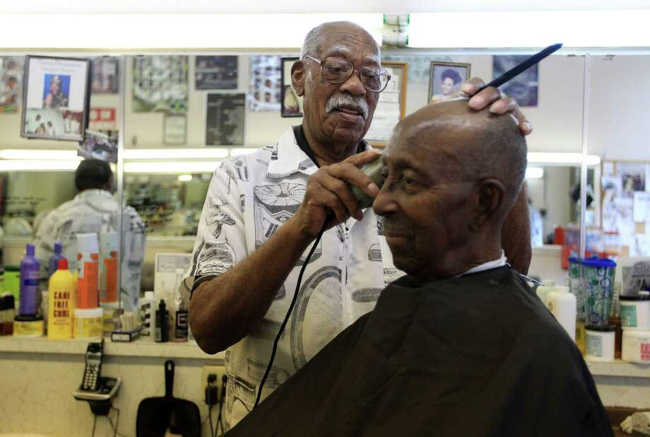 Sam Woods, 92, cuts ninety-six year old K.C. Ross's hair in the Parkview Barber Shop in the Third Ward, Wednesday, Sept. 18, 2013, in Houston. Woods, who has been cutting hair for 77 years, has cut his work load back, but he can still be found in the barber shop on a daily basis. Photo: Karen Warren, Houston Chronicle / © 2013 Houston Chronicle
