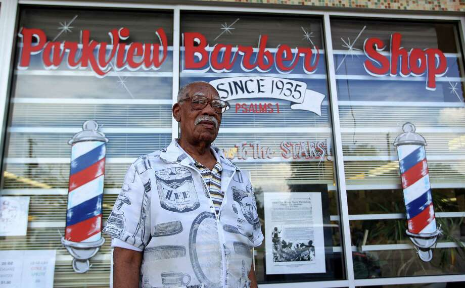 Sam Woods, 92, a barber for 77 years works in the Parkview Barber Shop in the Third Ward, Wednesday, Sept. 18, 2013, in Houston. Although he's cut his work load back, he can still be found in the barber shop on a daily basis. Photo: Karen Warren, Houston Chronicle / © 2013 Houston Chronicle