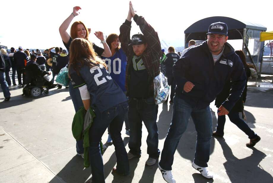 Seattle Seahawks fans dance on a concourse as the team plays the Jacksonville Jaguars on Sunday, Sept. 22, 2013 at CenturyLink Field in Seattle. Photo: SEATTLEPI.COM