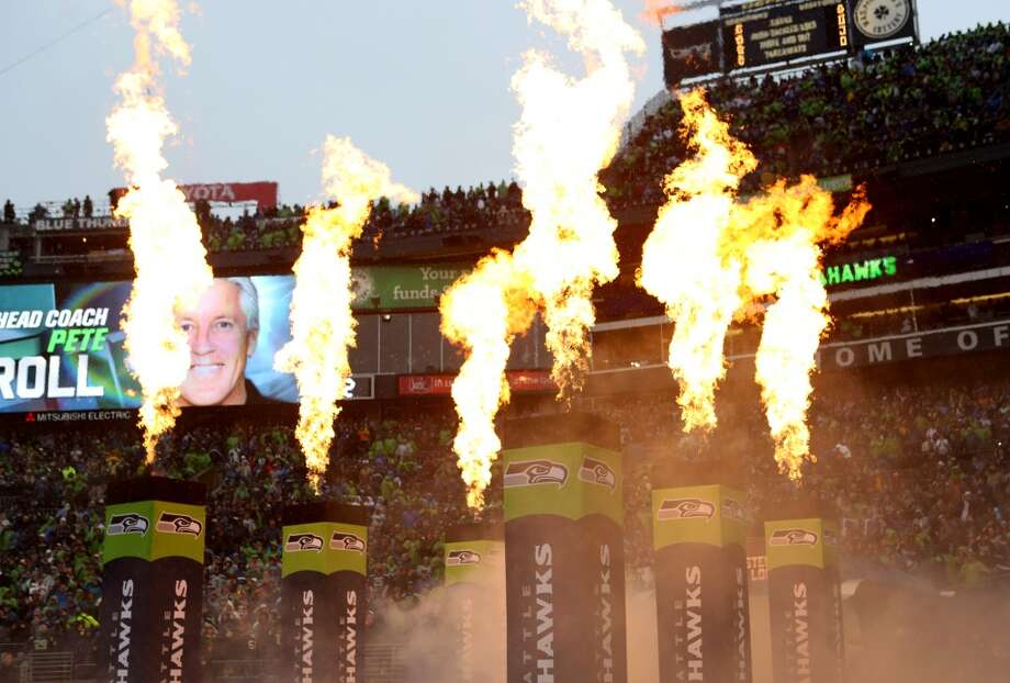 Flames shoot from pedestals as the Seattle Seahawks are introduced against the Jacksonville Jaguars on Sunday, Sept. 22, 2013 at CenturyLink Field in Seattle. Photo: SEATTLEPI.COM