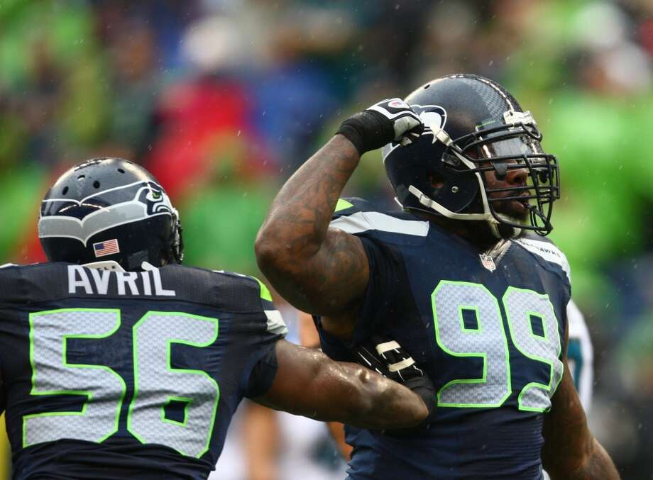 Seattle Seahawks player Tony McDaniel flexes after a play alongside Cliff Avril as they play the Jacksonville Jaguars on Sunday, Sept. 22, 2013 at CenturyLink Field in Seattle. Photo: SEATTLEPI.COM