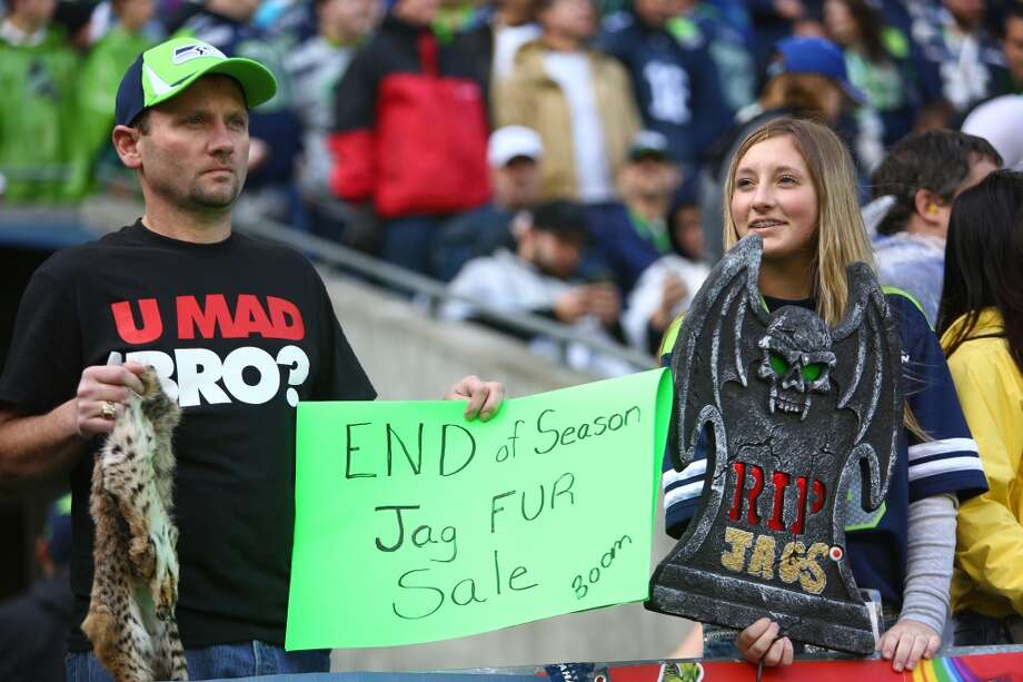 Seattle Seahawks fans hold up signs during play against the Jacksonville Jaguars on Sunday, Sept. 22, 2013 at CenturyLink Field in Seattle. Photo: SEATTLEPI.COM