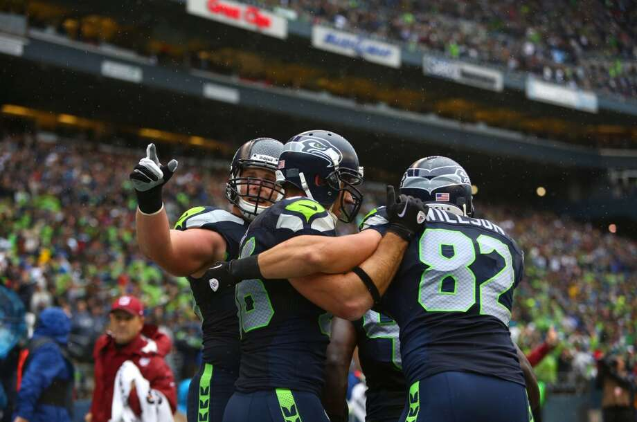 Seattle Seahawks player Zach Miller, center, celebrates with teammate Luke Willson after Miller scored a touchdown against the Jacksonville Jaguars on Sunday, Sept. 22, 2013 at CenturyLink Field in Seattle. Photo: SEATTLEPI.COM