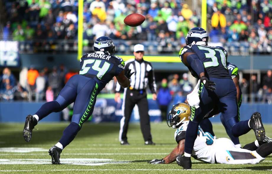 Seattle Seahawks players Bobby Wagner, left, and Kam Chancellor try to get to a ball bobbled by Jacksonville Jaguars player Maurice Jones-Drew on Sunday, Sept. 22, 2013 at CenturyLink Field in Seattle. Photo: SEATTLEPI.COM