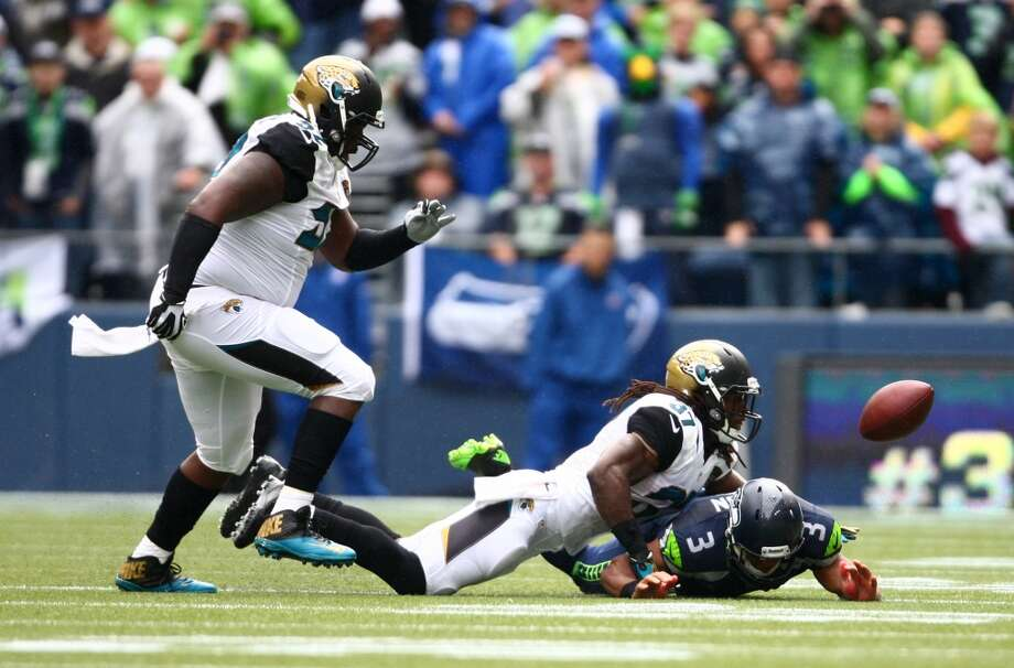 Jacksonville Jaguars players J.T. Thomas and Johnathan Cyprien chase a ball knocked from Seahawks quarterback Russell Wilson on Sunday, Sept. 22, 2013 at CenturyLink Field in Seattle. Photo: SEATTLEPI.COM