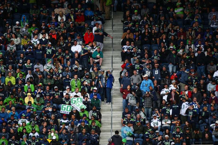 Seattle Seahawks fans watch the on-field action during play against the Jacksonville Jaguars on Sunday, Sept. 22, 2013 at CenturyLink Field in Seattle. Photo: SEATTLEPI.COM