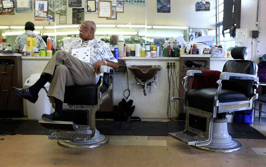 Sam Woods, 92, a barber for 77 years works in the Parkview Barber Shop in the Third Ward, Wednesday in Houston. Although he's cut his work load back, he can still be found in the barber shop on a daily basis. Photo: Karen Warren, Staff / © 2013 Houston Chronicle