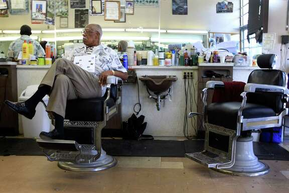 Sam Woods, 92, a barber for 77 years works in the Parkview Barber Shop in the Third Ward, Wednesday in Houston. Although he's cut his work load back, he can still be found in the barber shop on a daily basis.
