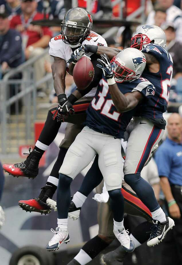 FOXBORO, MA - SEPTEMBER 22:  Devin McCourty #32 of the New England Patriots and Aqib Talib #31 of the New England Patriots break up a pass intended for Mike Williams #19 of the Tampa Bay Buccaneers during the first half at Gillette Stadium on September 22, 2013 in Foxboro, Massachusetts.  (Photo by Winslow Townson/Getty Images) ORG XMIT: 175879802 Photo: Winslow Townson / 2013 Getty Images