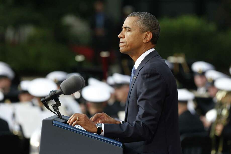 President Barack Obama speaks at a memorial service Sunday for the victimsof the Washington Navy Yard shooting. Photo: Charles Dharapak, Associated Press