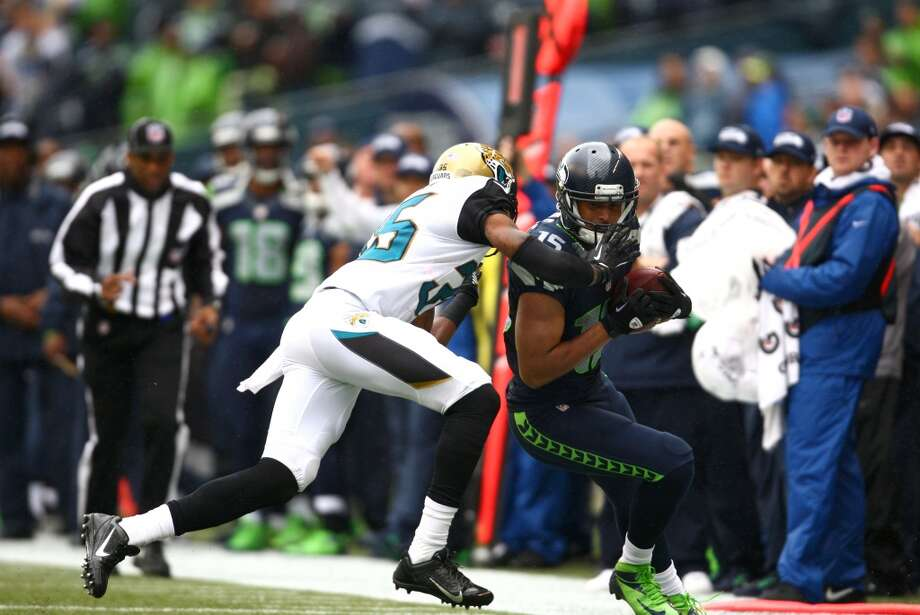 Seattle Seahawks player Jermaine Kearse is pushed out of bounds by Jacksonville Jaguars player Demetrius McCray on Sunday, Sept. 22, 2013 at CenturyLink Field in Seattle. Photo: SEATTLEPI.COM