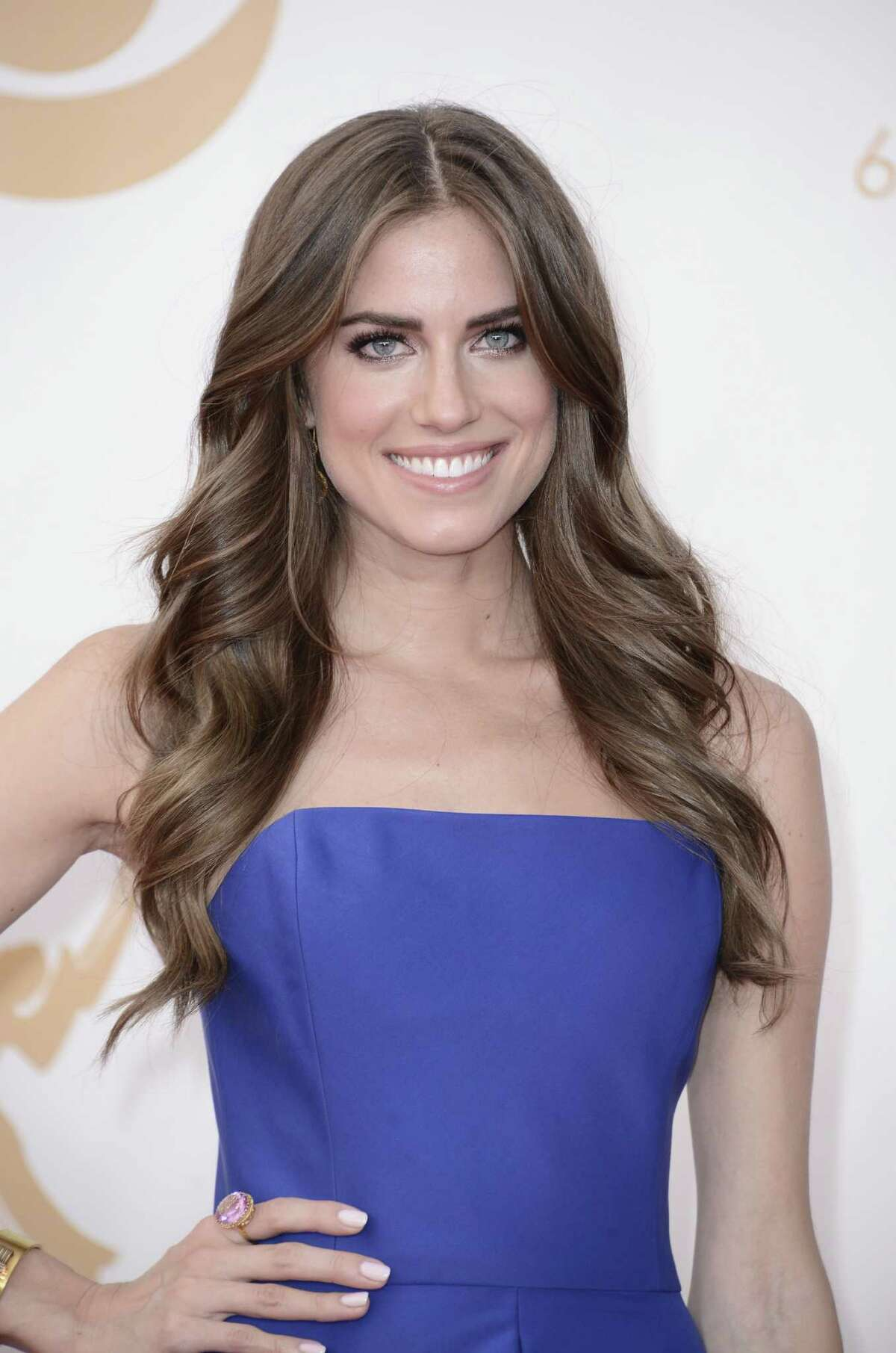 Allison Williams, wearing Ralph Lauren, arrives at the 65th Primetime Emmy Awards at Nokia Theatre on Sunday Sept. 22, 2013, in Los Angeles. (Photo by Dan Steinberg/Invision/AP)