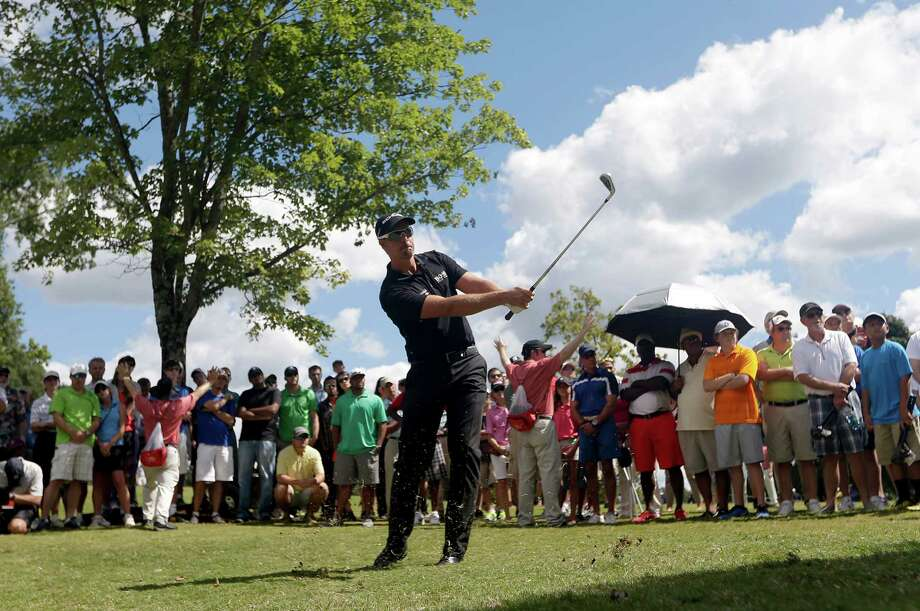 Henrik Stenson, of Sweden, hits out of the woods on the first hole during the final round of play in the Tour Championship golf tournament at East Lake Golf Club, in Atlanta, Sunday, Sept. 22, 2013. (AP Photo/John Bazemore) ORG XMIT: GAJB115 Photo: John Bazemore / AP