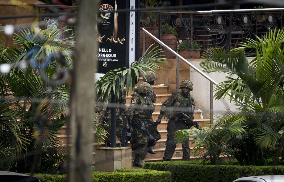 Kenyan soldiers carried a wounded colleague out of the Westgate Mall on Sunday in Nairobi, Kenya. Somalia's al-Shabab militia claimed responsibility for the attack over the weekend that killed 68. Photo: Ben Curtis / Associated Press