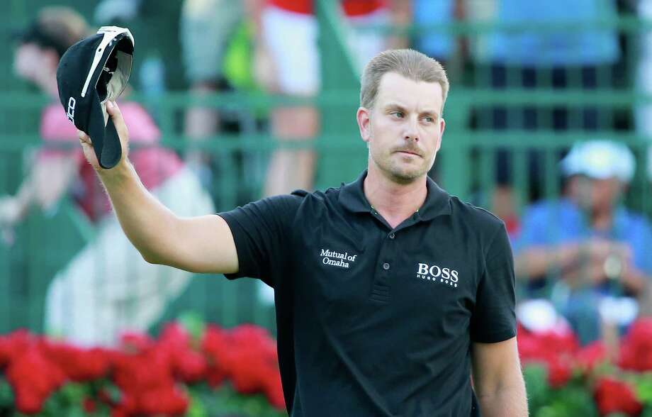 Sweden's Henrik Stenson doesn't look like a guy who just won the biggest golf tournament of his career and will collect $11.44 million for his efforts. Photo: Sam Greenwood, Staff / 2013 Getty Images