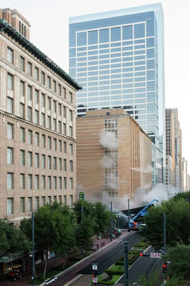 A series of explosive charges brings down the landmark former Macy's department store building in downtown Houston on Sunday, Sept. 22, 2013. Many Houstonians remember the store as Foley's, a homegrown retail chain that started downtown in 1900. As the store grew, it relocated and eventually moved into the building at 1110 Main in 1947. It was converted to Macy's in 2006 and operated at the site until  closing in March. The 10-story, 791,000-square-foot building was reduced to rubble just after sunrise to make way for a still undisclosed new development. ( Smiley N. Pool / Houston Chronicle ) Photo: Smiley N. Pool, Staff / © 2013  Houston Chronicle