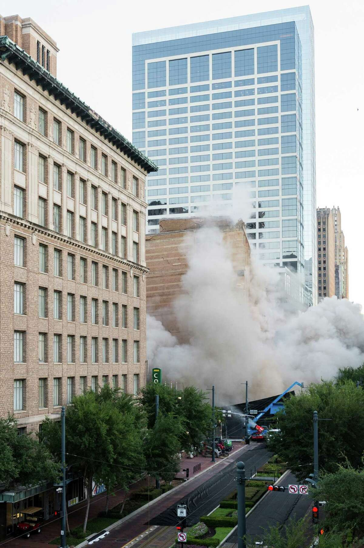 A series of explosive charges brings down the landmark former Macy's department store building in downtown Houston on Sunday, Sept. 22, 2013. Many Houstonians remember the store as Foley's, a homegrown retail chain that started downtown in 1900. As the store grew, it relocated and eventually moved into the building at 1110 Main in 1947. It was converted to Macy's in 2006 and operated at the site until closing in March. The 10-story, 791,000-square-foot building was reduced to rubble just after sunrise to make way for a still undisclosed new development. ( Smiley N. Pool / Houston Chronicle )