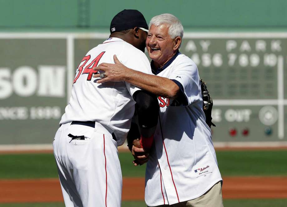 Hall of Famer Carl Yastrzemski, right, hugs Boston Red Sox's David Ortiz, left, after throwing out the ceremonial first pitch at Fenway Park, in Boston, Sunday, Sept. 22, 2013, before a baseball game between the Toronto Blue Jays and the Boston Red Sox. Yastrzemski attended a ceremony held to unveil a statue of himself at Fenway Park earlier in the day. (AP Photo/Steven Senne) ORG XMIT: MASR110 Photo: Steven Senne / AP