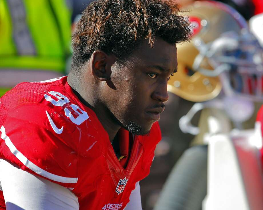 Aldon Smith sits on the bench as the clock winds down toward a loss to the Colts. The San Francisco 49ers played the Indianapolis Colts at Candlestick Park in San Francisco, Calif., on Sunday, September 22, 2013. The 49ers lost to the Colts 27-7. Photo: Carlos Avila Gonzalez, The Chronicle