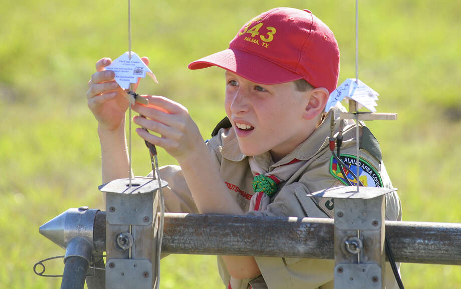 Harrison Bendet of Boy Scout troop 343 in Selma adjusts a raffle rocket during Alan's Hero's fundraiser benefiting pediatric cancer research Sunday at Kitty Hawk Flying Field. The fund is named after Alan Sander who died January 17 at the age of 5. Photo: For The San Antonio Express-News
