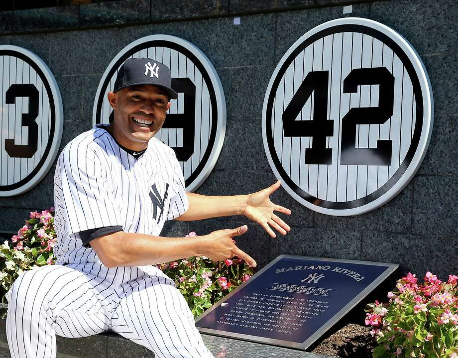 Mariano Rivera enjoys his plaque and retired number in Yankee Stadium's Monument Park during ceremonies before Sunday's game. Photo: Elsa, Staff / 2013 Getty Images