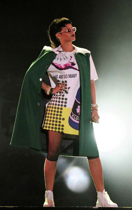 Rihanna performs on Sunday, Sept. 22, 2013, on the sidelines of the Formula One Singapore Grand Prix race weekend in Singapore.(AP Photo/Joseph Nair) Photo: Joseph Nair, STR / AP
